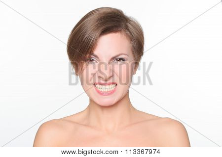 portrait of a beautiful woman with bare shoulders and short hair.  growls irritably. It expresses ag