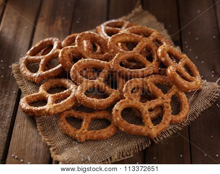 pile of salted pretzels on wooden table