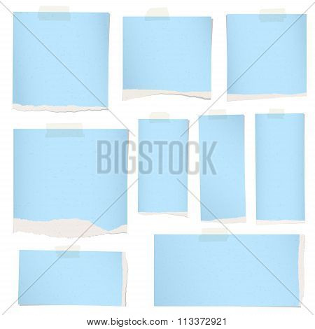 Pieces of torn blue grainy note paper with adhesive tape.