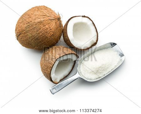 grated, whole and halved coconut on white background