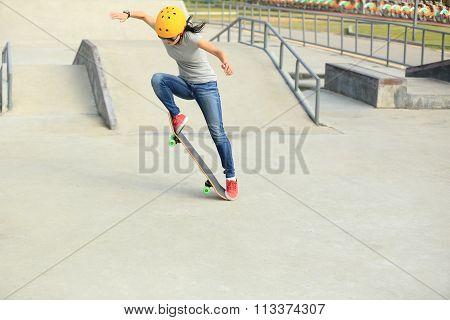 skateboarding woman at skatepark