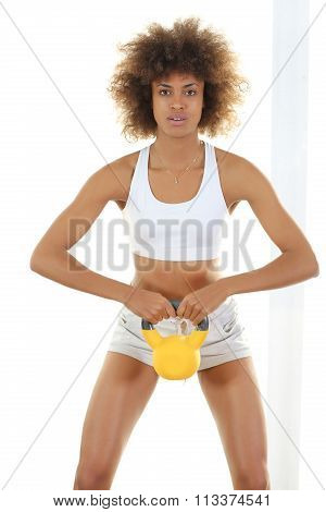 Young black woman shappes her body indoors