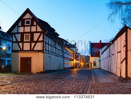 Narrow street with half-timbered residential houses. Lithuania