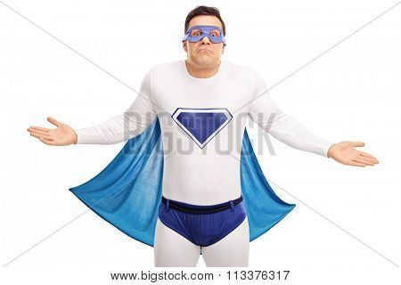 Confused superhero with a blue cape gesturing with his hands isolated on white background