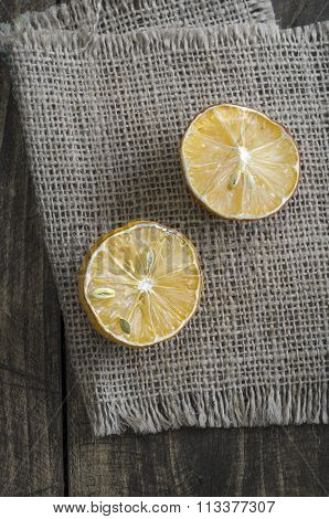 Dried  Lemon  Slices On Rusty Dark Wooden Table