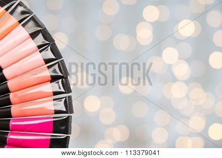 close up of lip gloss tubes over lights