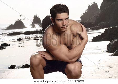 Bodybuilder At Beach