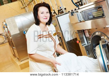 Laundry services. woman with washing machine