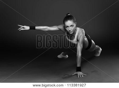 Young Woman Doing Push-Ups