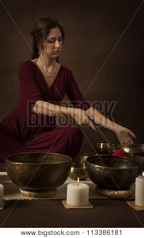 Woman With Tibetan Singing Bowls