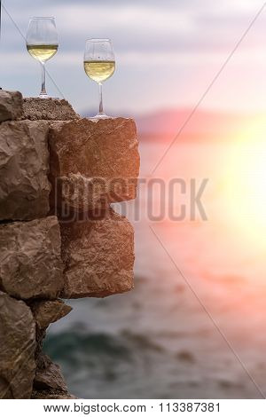 Two Wine Glasses On Stone