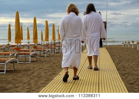 Two Adults In Warm Bathrobes