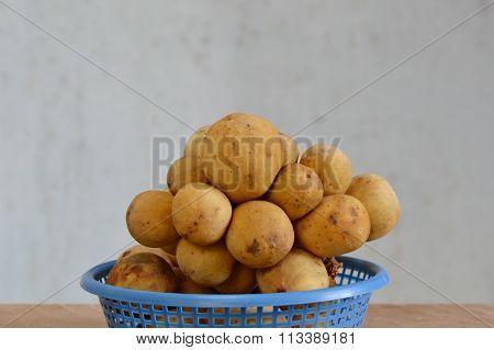 Langsat Asean fruit on blue basket