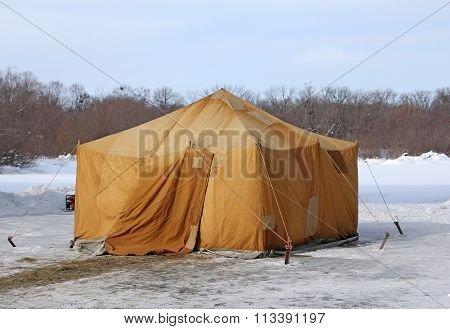 Military Khaki Tent In The Snow Polar Region In A Forest