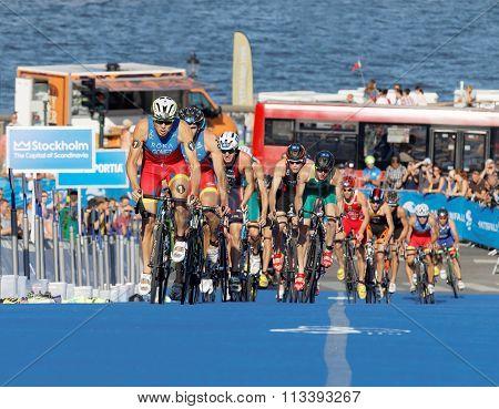 Spanish Triathlon Competitors Cycling Uphill