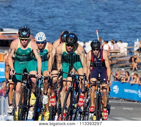 Group Of Australien Triathlon Competitors Cycling Uphill