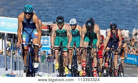 Group Of Triathlon Competitors Cycling Uphill