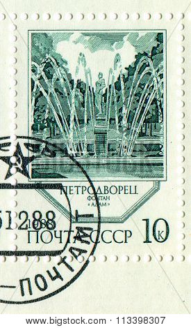USSR - CIRCA 1988: A stamp printed in USSR shows image of the Fountains of Peterhof Adam, circa 1988.