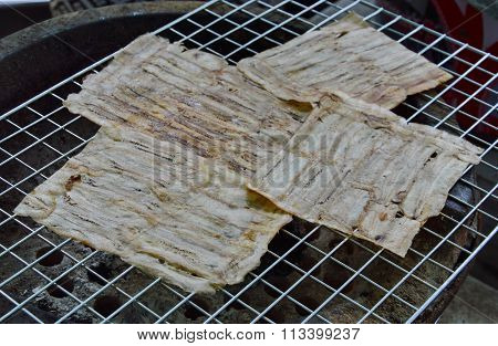 grilled flat banana Cambodian food on gridiron