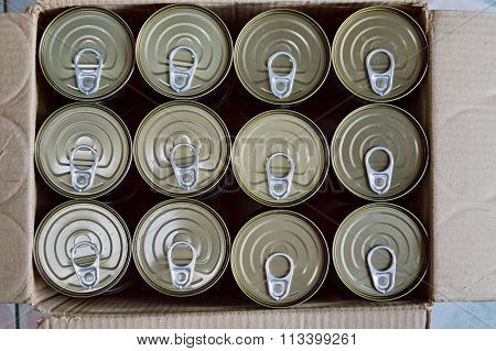 tin food can in paper box