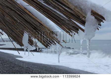 Thatched Roof On A Beach Umbrella At Winter