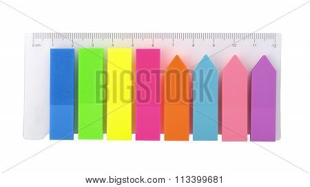 Colored plastic stickers stationery on a white background