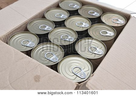 tin food can in brown paper box