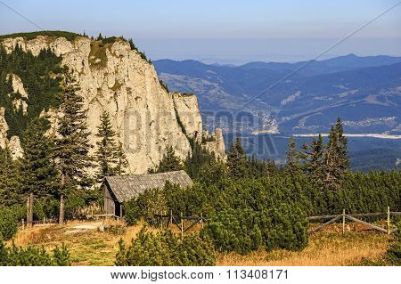 Wooden refuge in mountain landscape