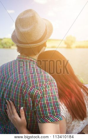 Love couple watching sunset
