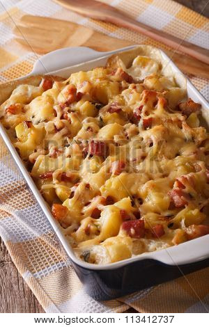 Tartiflette: Baked Potatoes With Bacon And Cheese Close Up, Vertical