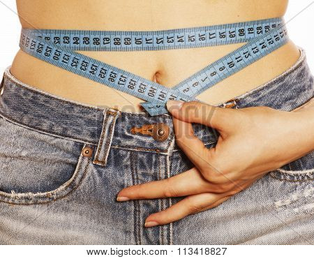 girls stomach measuring with tape twice isolated