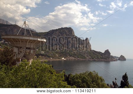 Three Mountains and Radiotelescope on the Seashore