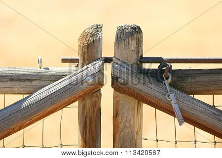 A lodge pole fence with a clothespin.