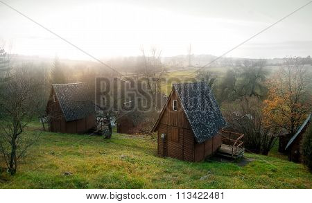Wooden lodges in a forest