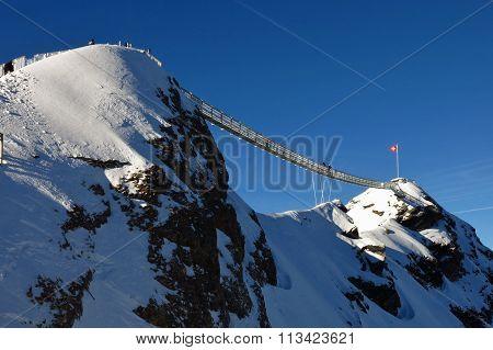 Suspension Bridge Connesting Two Mountain Peaks