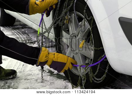 Snow Chains In The Car Tyre In Winter On Snow