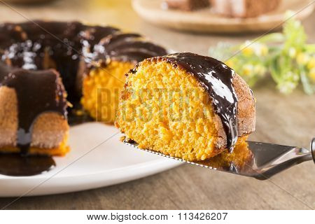 Carrot Cake With Chocolate And Slice On The Table