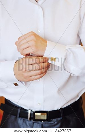 Man Puts Cufflinks On Sleeve White Shirts
