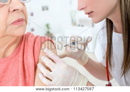 Injection in her shoulder