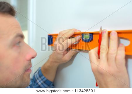 Handyman using a spirit level