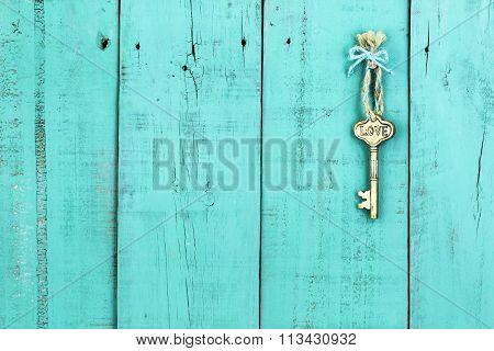 Skeleton key hanging on rustic door