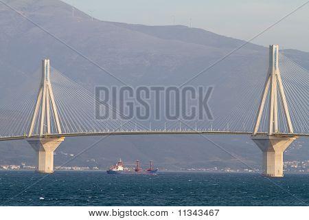 Ship Sailing Under The Bridge