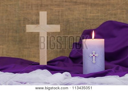 Easter composition with candle and wood cross