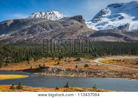 Icefields Parkway Road and giant glaciers in the mountains. Beautiful nature of the Rocky Mountains of Canada