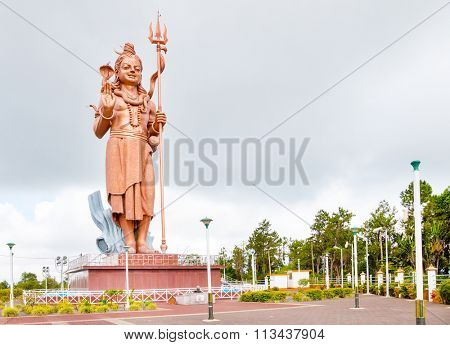 GANGA TALAO, MAURITIUS - 28. OCTOBER, 2015: Mangal Mahadev - Shiva Statue, 33 m tall Hindu god, standing at the entrance of Ganga Talao - Grand Bassin lake the most sacred Hindu place on Mauritius.