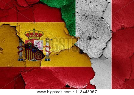 Flags Of Spain And Italy Painted On Cracked Wall