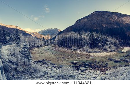 River curve with forest covered in frost.