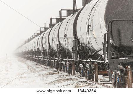 Line Of Railway Tank Cars In Winter
