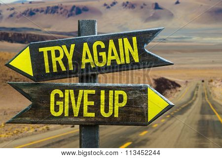 Try Again - Give Up signpost in a desert background