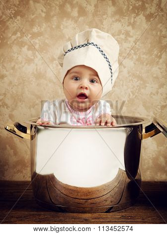 Cute Baby Chef In A Huge Cauldron